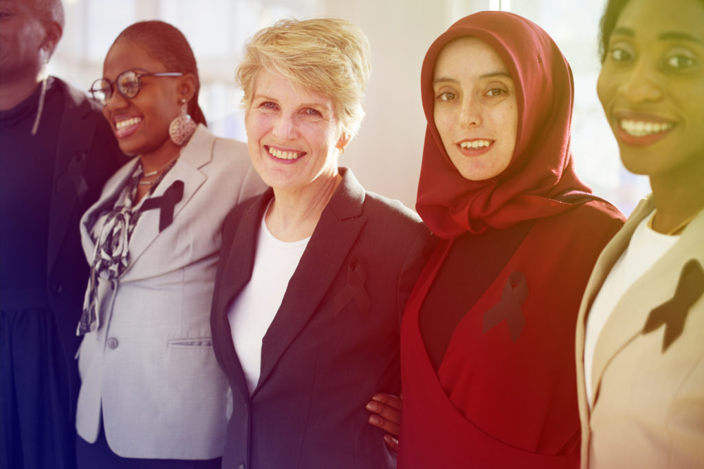 Women of different ethnicities smiling together.